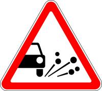 Дорожный знак: 1.18 Выброс гравия